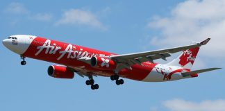 """AirAsia low cost carrier with slogan """"Now Everyone Can Fly"""""""