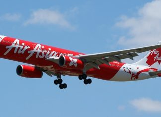 "AirAsia low cost carrier with slogan ""Now Everyone Can Fly"""